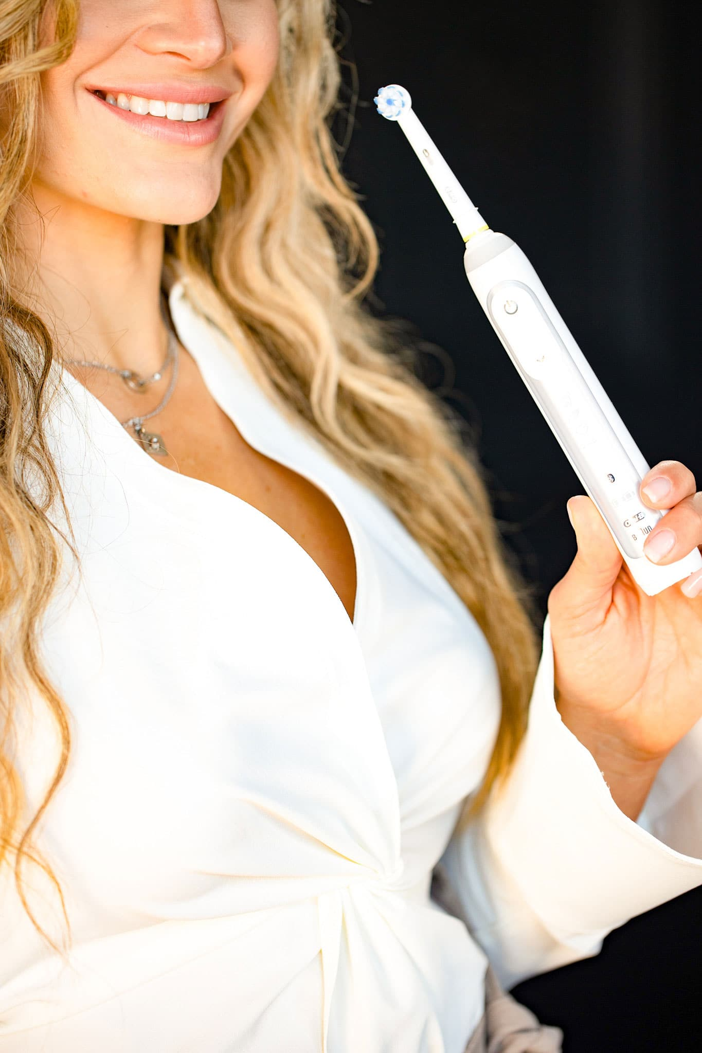 Dr. Jessica Tasios holding electric toothbrush